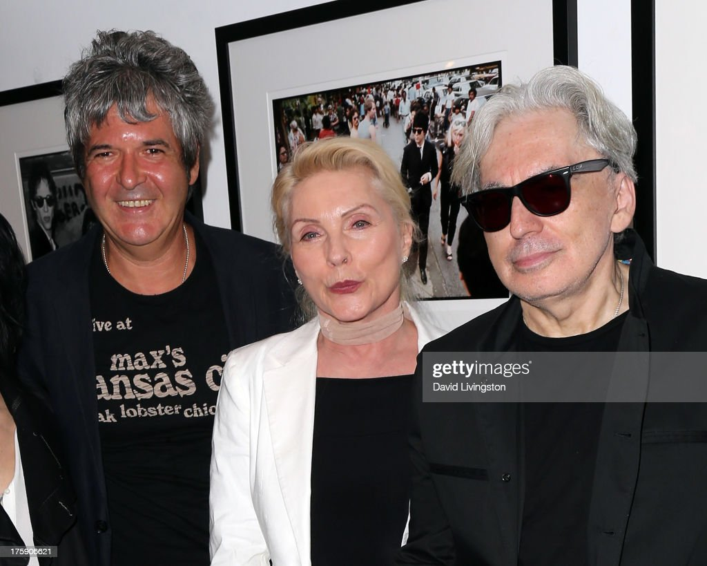Recording artists <a gi-track='captionPersonalityLinkClicked' href=/galleries/search?phrase=Clem+Burke&family=editorial&specificpeople=618427 ng-click='$event.stopPropagation()'>Clem Burke</a>, <a gi-track='captionPersonalityLinkClicked' href=/galleries/search?phrase=Debbie+Harry&family=editorial&specificpeople=209145 ng-click='$event.stopPropagation()'>Debbie Harry</a> and <a gi-track='captionPersonalityLinkClicked' href=/galleries/search?phrase=Chris+Stein&family=editorial&specificpeople=239488 ng-click='$event.stopPropagation()'>Chris Stein</a> of Blondie attend the 'Hell in The City of Angels: <a gi-track='captionPersonalityLinkClicked' href=/galleries/search?phrase=Chris+Stein&family=editorial&specificpeople=239488 ng-click='$event.stopPropagation()'>Chris Stein</a>' photo exhibition opening at the Morrison Hotel Gallery on August 9, 2013 in West Hollywood, California.
