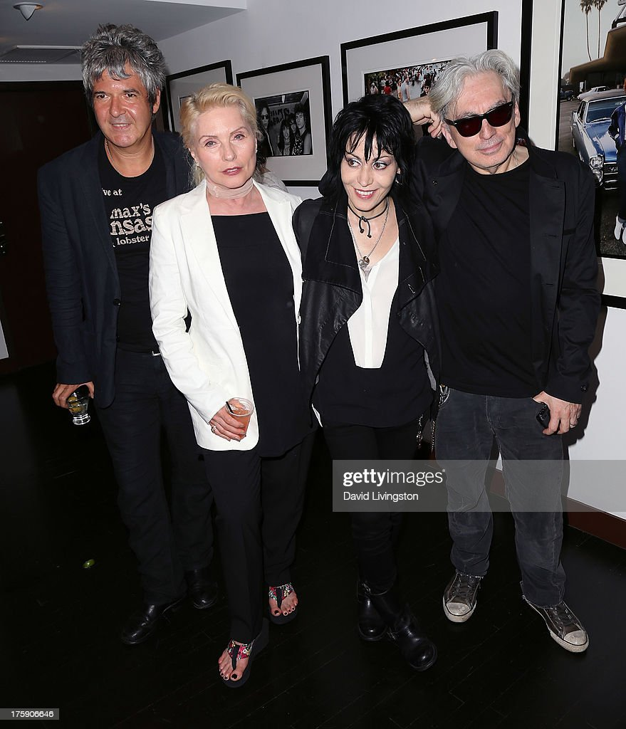 Recording artists <a gi-track='captionPersonalityLinkClicked' href=/galleries/search?phrase=Clem+Burke&family=editorial&specificpeople=618427 ng-click='$event.stopPropagation()'>Clem Burke</a>, <a gi-track='captionPersonalityLinkClicked' href=/galleries/search?phrase=Debbie+Harry&family=editorial&specificpeople=209145 ng-click='$event.stopPropagation()'>Debbie Harry</a>, <a gi-track='captionPersonalityLinkClicked' href=/galleries/search?phrase=Joan+Jett&family=editorial&specificpeople=213317 ng-click='$event.stopPropagation()'>Joan Jett</a> and <a gi-track='captionPersonalityLinkClicked' href=/galleries/search?phrase=Chris+Stein&family=editorial&specificpeople=239488 ng-click='$event.stopPropagation()'>Chris Stein</a> attend the 'Hell in The City of Angels: <a gi-track='captionPersonalityLinkClicked' href=/galleries/search?phrase=Chris+Stein&family=editorial&specificpeople=239488 ng-click='$event.stopPropagation()'>Chris Stein</a>' photo exhibition opening at the Morrison Hotel Gallery on August 9, 2013 in West Hollywood, California.