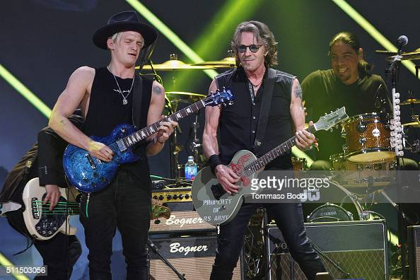 Recording artists Cody Simpson and Rick Springfield perform on stage during the iHeart80s Party 2016 at The Forum on February 20 2016 in Inglewood...