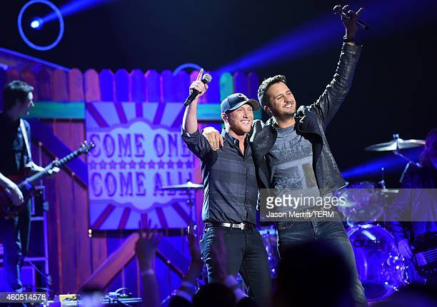 Recording artists Cole Swindell and Luke Bryan perform onstage during 2014 American Country Countdown Awards at Music City Center on December 15 2014...