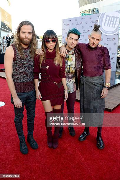 Recording artists Cole Whittle JinJoo Lee Joe Jonas and Jack Lawless of music group DNCE attend the 2015 American Music Awards red carpet arrivals...