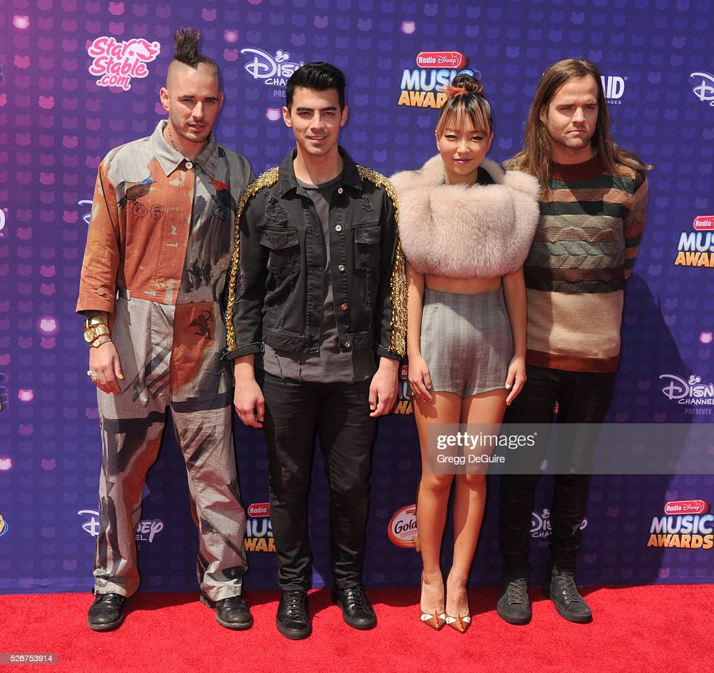 Recording artists Cole Whittle, Joe Jonas, JinJoo Lee, and Jack Lawless of DNCE arrive at the 2016 Radio Disney Music Awards at Microsoft Theater on April 30, 2016 in Los Angeles, California.