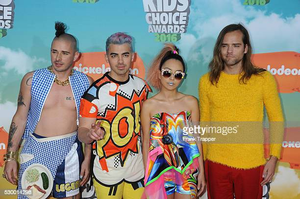 Recording artists Cole Whittle Joe Jonas JinJoo Lee and Jack Lawless of DNCE arrive at Nickelodeon's 2016 Kids' Choice Awards held at the Forum in...