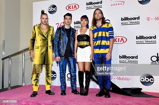 Recording artists Cole Whittle Joe Jonas JinJoo Lee and Jack Lawless of music group DNCE pose in the press room during the 2016 Billboard Music...