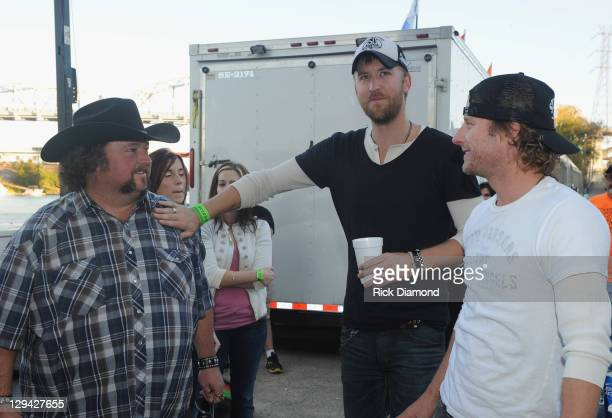 Recording Artists Colt Ford Charles Kelley of Lady Antebullem and Dierks Bentley backstage during Dierks Bentley's 6th annual Miles Music for Kids at...