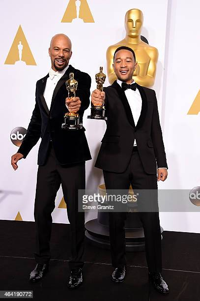 Recording artists Common and John Legend pose in the press room during the 87th Annual Academy Awards at Loews Hollywood Hotel on February 22 2015 in...
