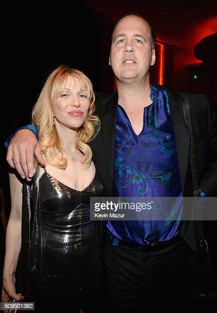 Recording artists Courtney Love in Saint Laurent by Hedi Slimane and Krist Novoselic attend Saint Laurent at the Palladium on February 10 2016 in Los...