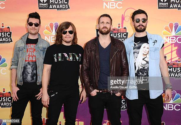 Recording artists Dan Smith Chris 'Woody' Wood Will Farquarson and Kyle Simmons of music group Bastille arrive at the 2014 iHeartRadio Music Awards...