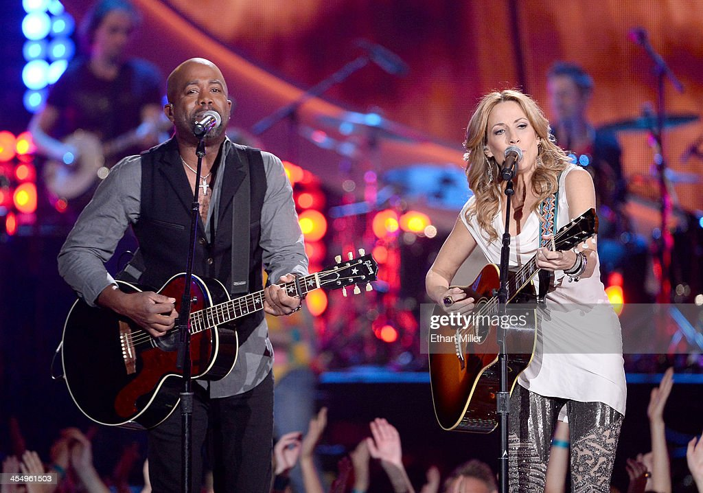Recording artists Darius Rucker and Sheryl Crow perform onstage during the American Country Awards 2013 at the Mandalay Bay Events Center on December...