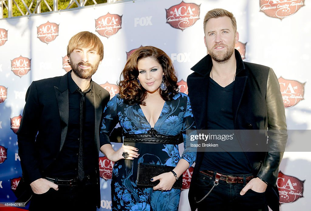 Recording artists Dave Haywood Hillary Scott and Charles Kelley of Lady Antebellum arrive at the American Country Awards 2013 at the Mandalay Bay...
