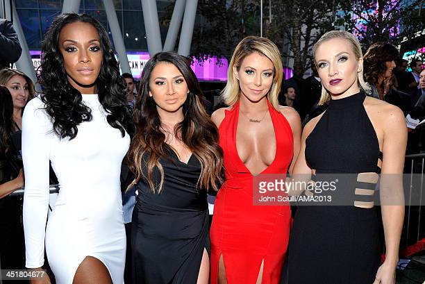 Recording artists Dawn Richards Andrea Fimbres Aubrey O'Day and Shannon Bex poses in the Music Choice Lounge at the 2013 American Music Awards at...