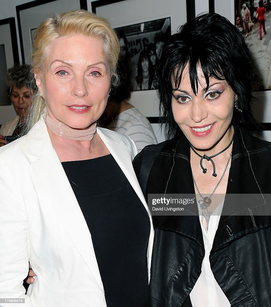 Recording artists <a gi-track='captionPersonalityLinkClicked' href=/galleries/search?phrase=Debbie+Harry&family=editorial&specificpeople=209145 ng-click='$event.stopPropagation()'>Debbie Harry</a> (L) and <a gi-track='captionPersonalityLinkClicked' href=/galleries/search?phrase=Joan+Jett&family=editorial&specificpeople=213317 ng-click='$event.stopPropagation()'>Joan Jett</a> attend the 'Hell in The City of Angels: Chris Stein' photo exhibition opening at the Morrison Hotel Gallery on August 9, 2013 in West Hollywood, California.