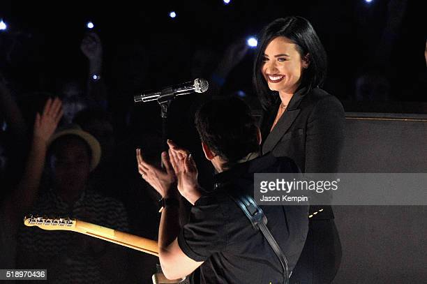 Recording artists Demi Lovato and Brad Paisley perform onstage at the iHeartRadio Music Awards which broadcasted live on TBS TNT AND TRUTV from The...
