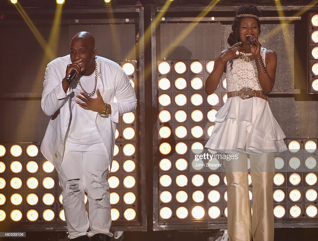 Recording artists Derek Minor and <a gi-track='captionPersonalityLinkClicked' href=/galleries/search?phrase=Nicole+C.+Mullen&family=editorial&specificpeople=2661301 ng-click='$event.stopPropagation()'>Nicole C. Mullen</a> perform onstage during the 46th Annual GMA Dove Awards at Allen Arena, Lipscomb University on October 13, 2015 in Nashville, Tennessee.