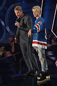 Recording artists Diplo and Justin Beiber accept the award for 'Dance Song of the Year' for 'Where are u now' onstage at the iHeartRadio Music Awards...