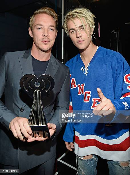 Recording artists Diplo and Justin Beiber winners of the award for 'Dance Song of the Year' for 'Where are u now' backstage at the iHeartRadio Music...