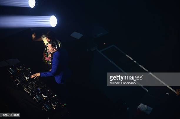 Recording artists DJ Tiesto and Quilla perform as 7UP Presents Tiesto's 'A Town Called Paradise' album release celebration at Terminal 5 on June 17...