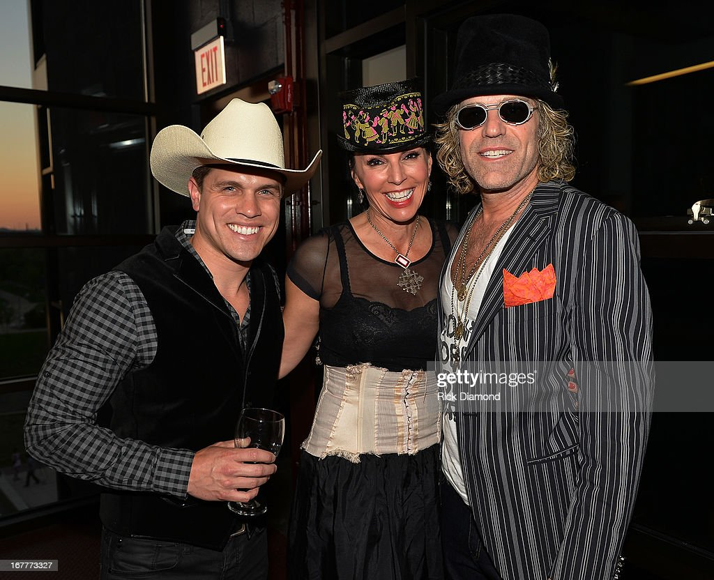 Recording Artists Dustin Lynch, Model Christiev Alphin and Big Kenny Alphin Christiev Alphinattend the 14th annual T.J. Martell Foundation Nashville Best Cellars dinner at the Bridge Building on April 29, 2013 in Nashville, Tennessee.