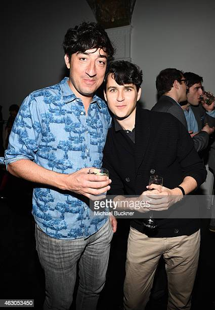 Recording artists Ed Droste of music group Grizzly Bear and Ezra Koenig of music group Vampire Weekend attend GQ and Giorgio Armani Grammys After...