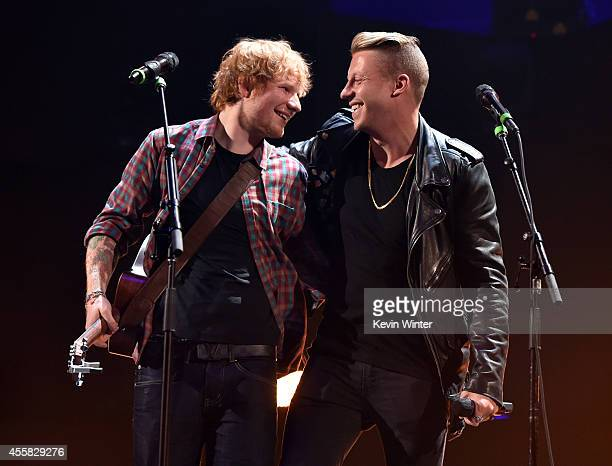 Recording artists Ed Sheeran and Macklemore perform ontage during the 2014 iHeartRadio Music Festival at the MGM Grand Garden Arena on September 20...
