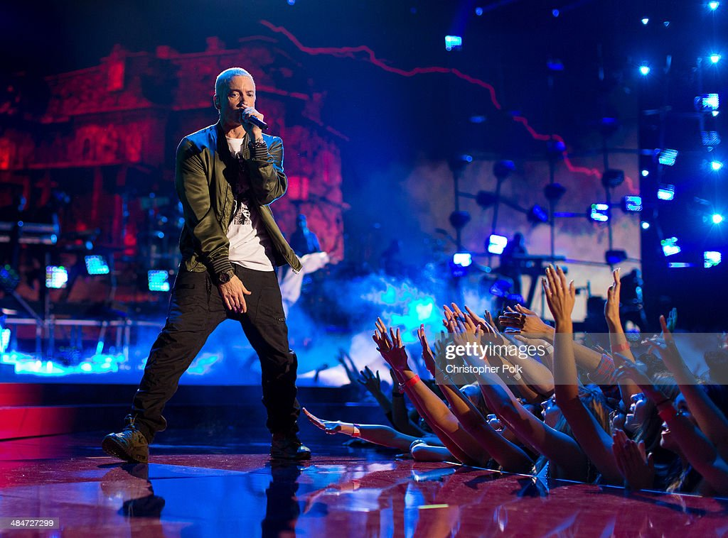 Recording artists <a gi-track='captionPersonalityLinkClicked' href=/galleries/search?phrase=Eminem&family=editorial&specificpeople=201900 ng-click='$event.stopPropagation()'>Eminem</a> performs onstage at the 2014 MTV Movie Awards at Nokia Theatre L.A. Live on April 13, 2014 in Los Angeles, California.