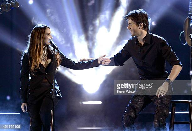 Recording artists Enrique Iglesias and India Martinez perform onstage during The 14th Annual Latin GRAMMY Awards at the Mandalay Bay Events Center on...