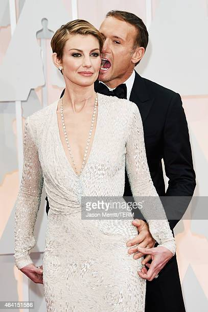 Recording artists Faith Hill and Tim McGraw attend the 87th Annual Academy Awards at Hollywood Highland Center on February 22 2015 in Hollywood...