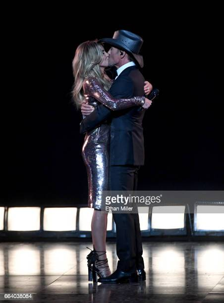 Recording artists Faith Hill and Tim McGraw kiss after performing together during the 52nd Academy of Country Music Awards at TMobile Arena on April...