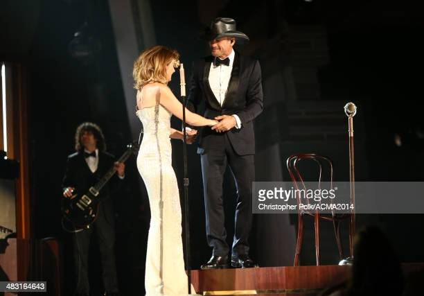 Recording artists Faith Hill and Tim McGraw perform onstage during the 49th Annual Academy of Country Music Awards at the MGM Grand Garden Arena on...