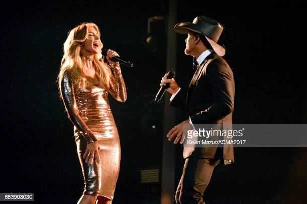 Recording artists Faith Hill and Tim McGraw perform onstage during the 52nd Academy of Country Music Awards at TMobile Arena on April 2 2017 in Las...
