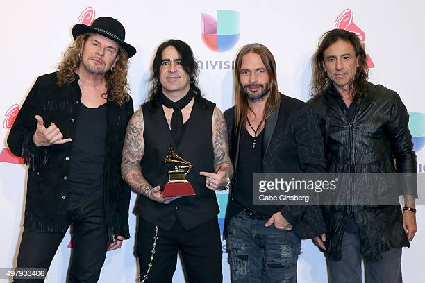 Recording artists Fher Olvera Alex Gonzalez Sergio Vallin and Juan Calleros of music group Mana winners of Best Pop/Rock Album award for 'Cama...