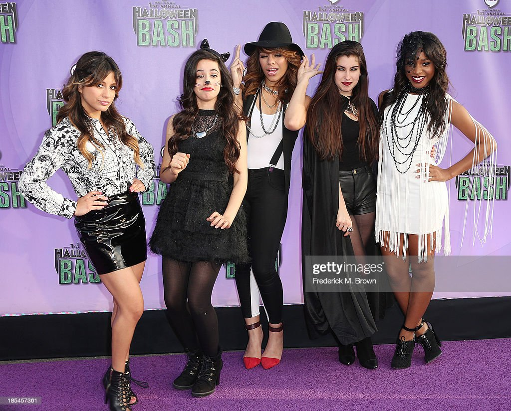 Recording artists <a gi-track='captionPersonalityLinkClicked' href=/galleries/search?phrase=Fifth+Harmony&family=editorial&specificpeople=9960104 ng-click='$event.stopPropagation()'>Fifth Harmony</a> attend Hub Network's First Annual Halloween Bash in Barker Hangar at the Santa Monica Airport on October 20, 2013 in Santa Monica, California.
