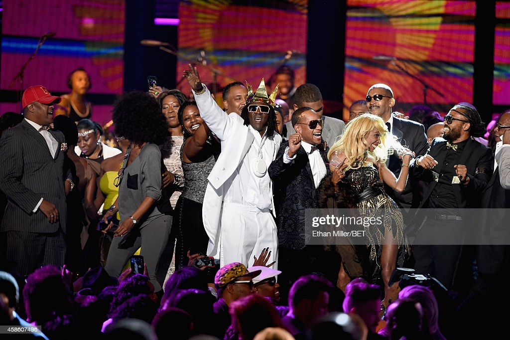 Recording artists Flavor Flav (C) and Machel Montano (far R) dance onstage during the 2014 Soul Train Music Awards at the Orleans Arena on November 7, 2014 in Las Vegas, Nevada.