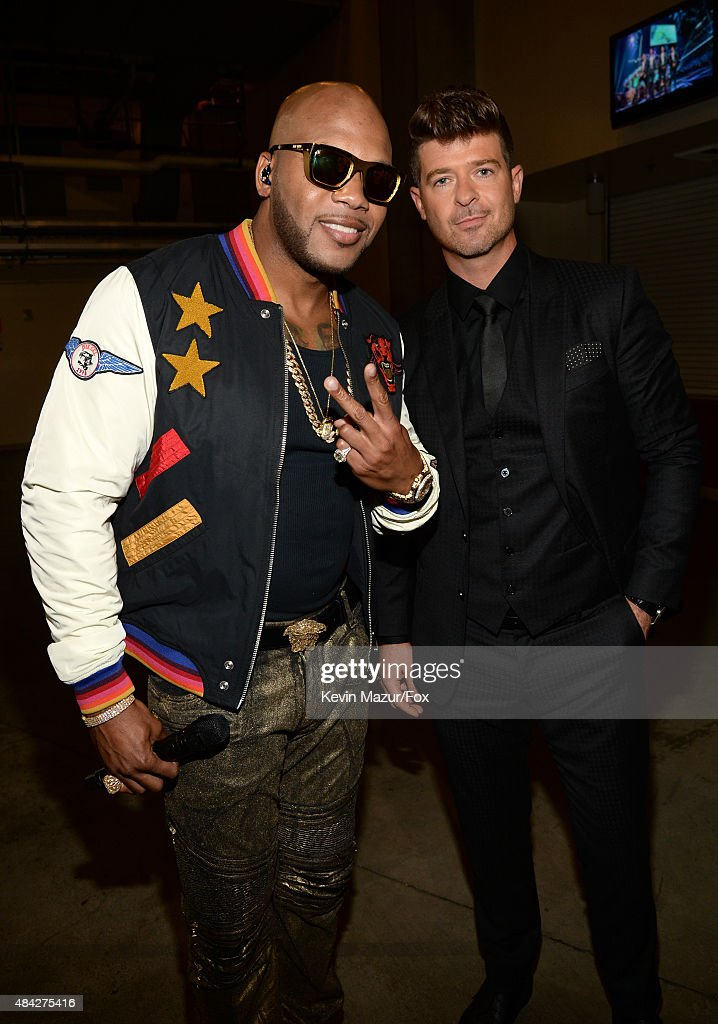 Recording artists Flo Rida and Robin Thicke attend the Teen Choice Awards 2015 at the USC Galen Center on August 16 2015 in Los Angeles California