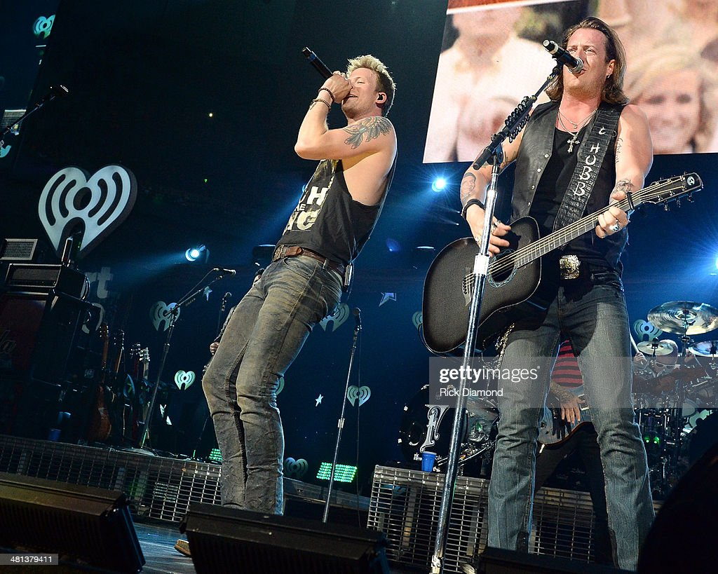 Recording artists Florida Georgia Line's Brian Kelley (L) and Tyler Hubbard perform onstage during iHeartRadio Country Festival in Austin at the Frank Erwin Center on March 29, 2014 in Austin, Texas.