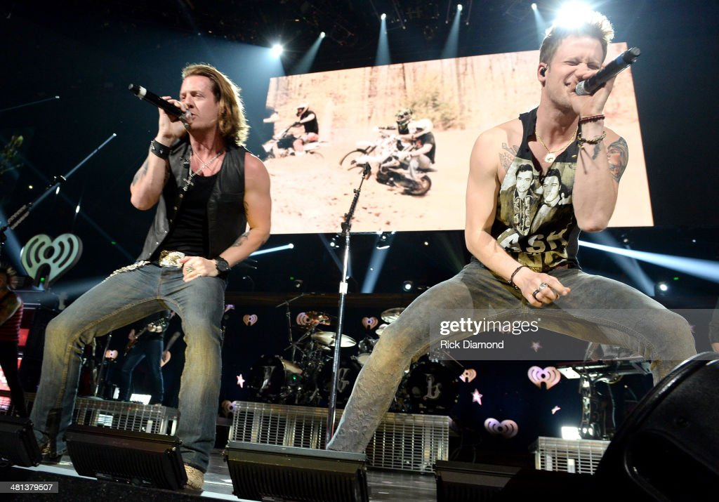 Recording artists Florida Georgia Line's Tyler Hubbard (L) and Brian Kelley perform onstage during iHeartRadio Country Festival in Austin at the Frank Erwin Center on March 29, 2014 in Austin, Texas.