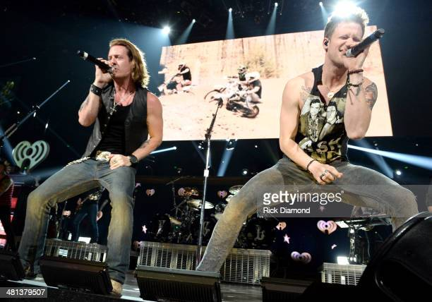 Recording artists Florida Georgia Line's Tyler Hubbard and Brian Kelley perform onstage during iHeartRadio Country Festival in Austin at the Frank...