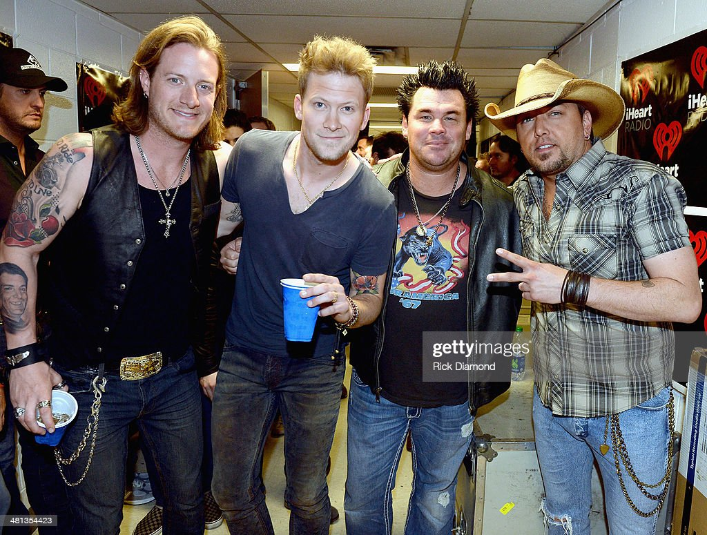 Recording artists Florida Georgia Line's <a gi-track='captionPersonalityLinkClicked' href=/galleries/search?phrase=Tyler+Hubbard&family=editorial&specificpeople=9453787 ng-click='$event.stopPropagation()'>Tyler Hubbard</a>, Brian Kelley, DJ DJ Silver and recording artist <a gi-track='captionPersonalityLinkClicked' href=/galleries/search?phrase=Jason+Aldean&family=editorial&specificpeople=619221 ng-click='$event.stopPropagation()'>Jason Aldean</a> attend iHeartRadio Country Festival in Austin at the Frank Erwin Center on March 29, 2014 in Austin, Texas.