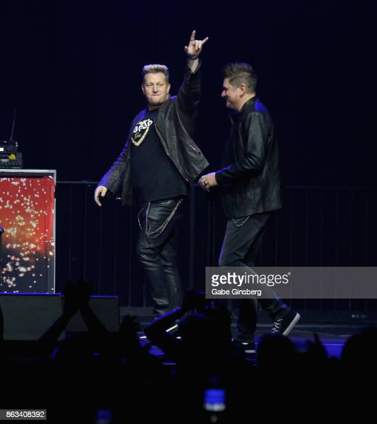 Recording artists Gary LeVox and Jay DeMarcus of Rascal Flatts walk onstage during 'Vegas Strong A Night of Healing' at the Orleans Arena on October...