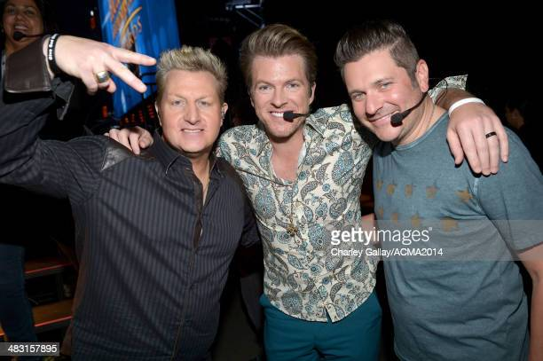 Recording artists Gary LeVox Joe Don Rooney and Jay DeMarcus pose backstage at the ACM Fan Jam during the 49th Annual Academy of Country Music Awards...