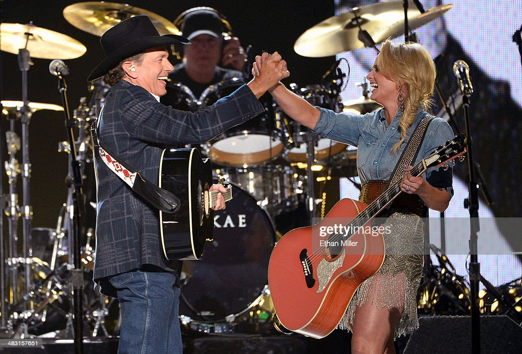 Recording artists <a gi-track='captionPersonalityLinkClicked' href=/galleries/search?phrase=George+Strait&family=editorial&specificpeople=234588 ng-click='$event.stopPropagation()'>George Strait</a> (L) and <a gi-track='captionPersonalityLinkClicked' href=/galleries/search?phrase=Miranda+Lambert&family=editorial&specificpeople=571972 ng-click='$event.stopPropagation()'>Miranda Lambert</a> perform onstage during the 49th Annual Academy of Country Music Awards at the MGM Grand Garden Arena on April 6, 2014 in Las Vegas, Nevada.