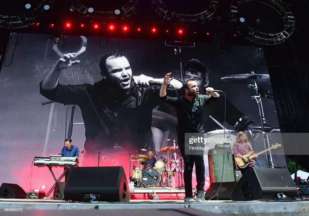 Recording artists Gerrit Welmers, Michael Lowry, Samuel T. Herring, and William Cashion of Future Islands perform onstage at What Stage during Day 3 of the 2017 Bonnaroo Arts And Music Festival on June 10, 2017 in Manchester, Tennessee.