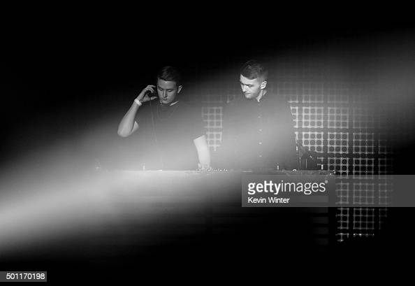 Recording artists Guy Lawrence and Howard Lawrence of Disclosure perform onstage during 1067 KROQ Almost Acoustic Christmas 2015 at The Forum on...