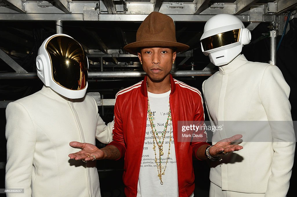 Recording artists Guy-Manuel de Homem-Christo (L), Pharrell Williams and Thomas Bangalter, winners of Record of the Year and Album of the Year for 'Random Access Memories' attend the 56th GRAMMY Awards at Staples Center on January 26, 2014 in Los Angeles, California.