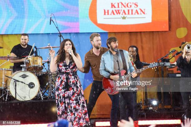 Recording artists Hillary Scott Charles Kelley and Dave Haywood of Lady Antebellum perform on ABC's 'Good Morning America' at Rumsey Playfield on...