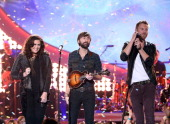 Recording artists Hillary Scott Dave Haywood and Charles Kelley of Lady Antebellum perform onstage during the American Country Awards 2013 at the...