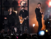 Recording artists Hillary Scott Dave Haywood and Charles Kelley of Lady Antebellum perform onstage during the 50th Academy of Country Music Awards at...