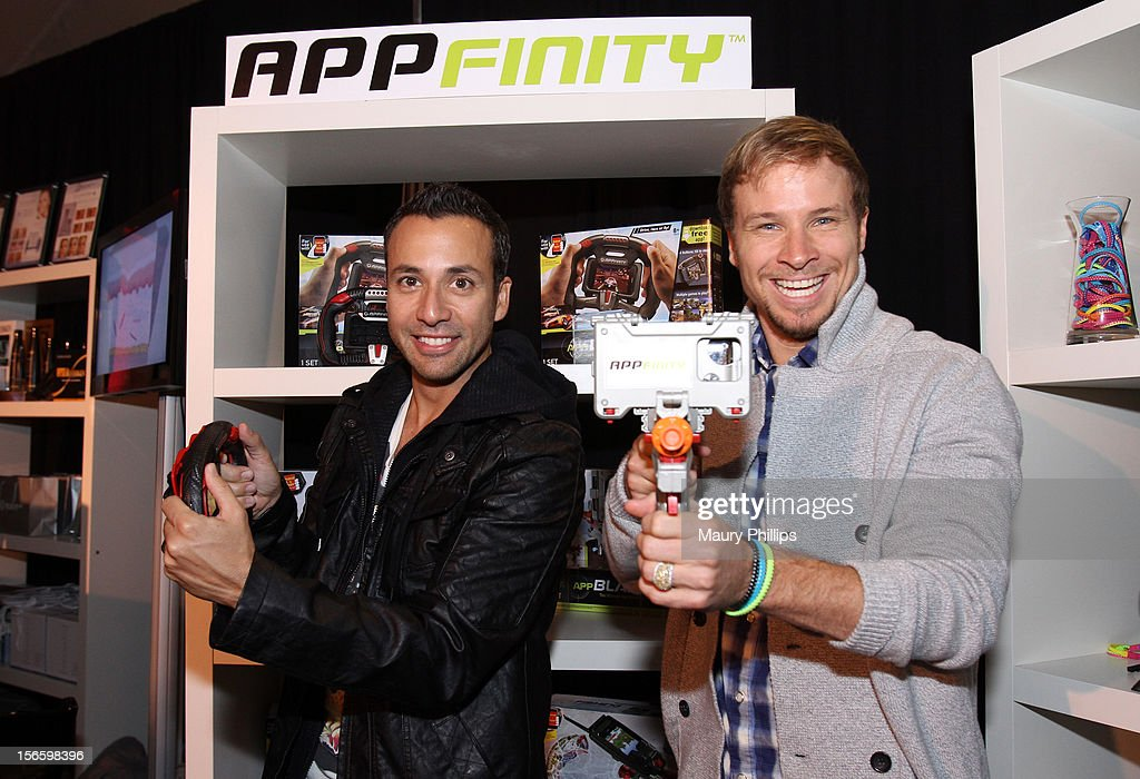 Recording artists <a gi-track='captionPersonalityLinkClicked' href=/galleries/search?phrase=Howie+Dorough&family=editorial&specificpeople=204770 ng-click='$event.stopPropagation()'>Howie Dorough</a> and <a gi-track='captionPersonalityLinkClicked' href=/galleries/search?phrase=Brian+Littrell&family=editorial&specificpeople=215310 ng-click='$event.stopPropagation()'>Brian Littrell</a> of the Backstreet Boys visit the American Music Awards Artists Gift Lounge - Day 2 at LA Live on November 17, 2012 in Los Angeles, California.