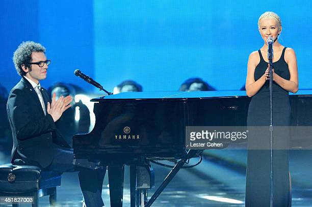 Recording artists Ian Axel of music group A Great Big World and Christina Aguilera perform onstage during the 2013 American Music Awards at Nokia...