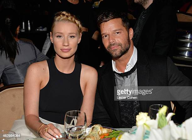 Recording artists Iggy Azalea and Ricky Martin attend the PreGRAMMY Gala and Salute to Industry Icons honoring Martin Bandier at The Beverly Hilton...